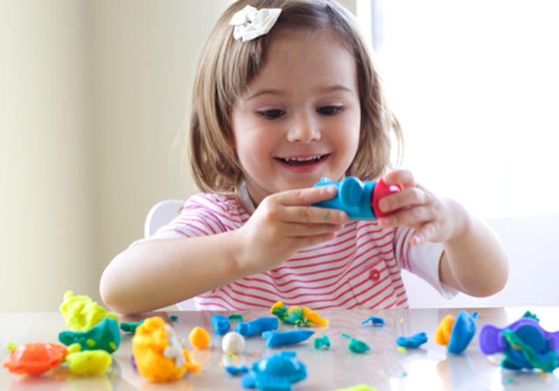 Building different objects with playdoh can help children develop their imagination.